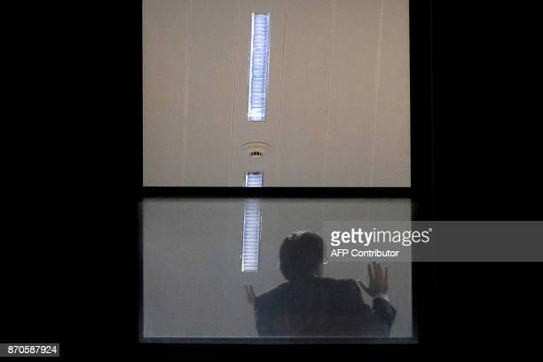 TOPSHOT A man believed to be Carles Puigdemont gestures inside the public prosecutor's office in Brussels on November 5 2017 Catalonia's sacked...