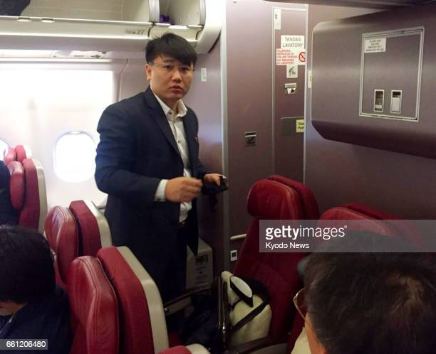 A man believed to be Kim Uk Il an employee of North Korea's national airline Air Koryo is pictured on a plane ahead of its departure from Kuala...