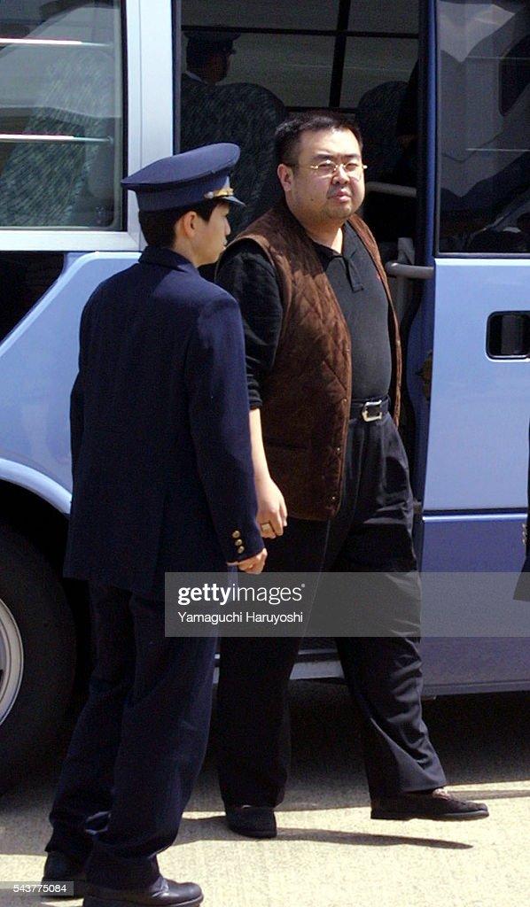 A man believed to be North Korean heir-apparent Kim Jong Nam is escorted by police as he boards a plane upon his deportation from Japan at Tokyo's Narita International Airport. Believed to be the eldest son of North Korean leader Kim Jong-Il, the man entered Japan with a forged passport on May 1, 2001 and is to be deported to China.