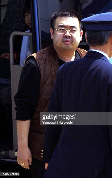 A man believed to be North Korean heirapparent Kim Jong Nam is escorted by police as he boards a plane upon his deportation from Japan at Tokyo's...
