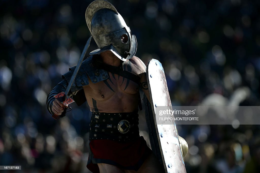 A man belonging to historical groups fights dressed as an ancient Roman gladiator during a show to mark the anniversary of the legendary foundation of the eternal city in 753 B.C, in Rome's Circo Massimo on April 21, 2013. AFP PHOTO / Filippo MONTEFORTE