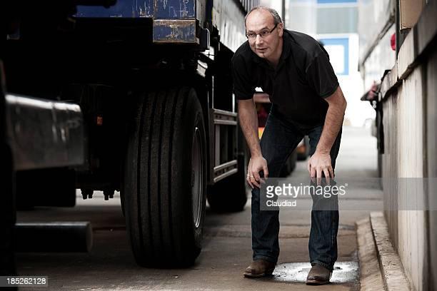 Man between trucks