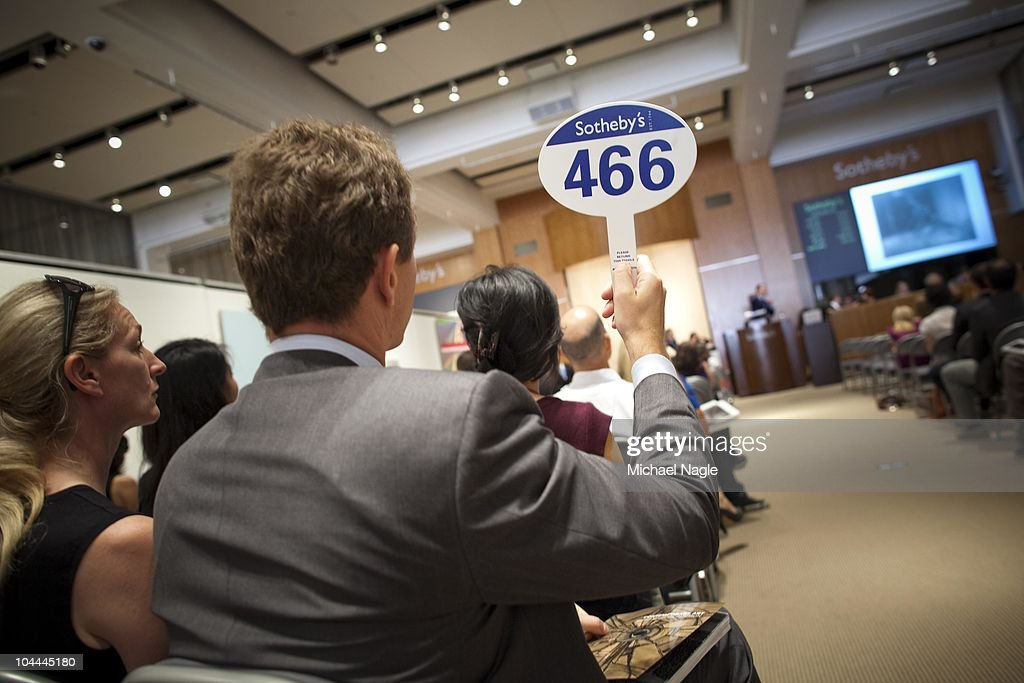 A man bids on a piece of art at Sotheby's auctions off Art from Lehman Brothers' collection on September 25, 2010 in New York City. The sales from the Sotheby's auction and upcoming auctions at Christie's in London and Freeman's in Philadelphia would be used to repay creditors of the collapsed investment bank group.