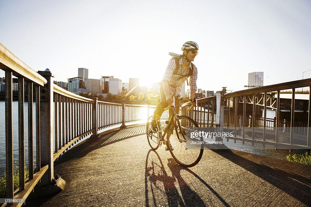A man bike commuting. : Stock Photo