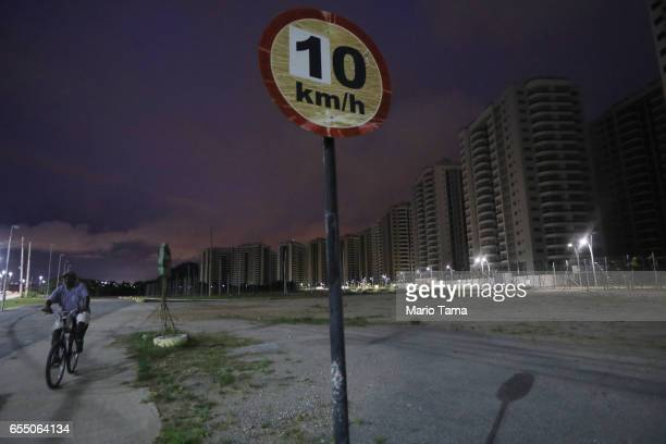 A man bikes past the abandoned Athlete's Village on March 13 2017 in Rio de Janeiro Brazil Seven months after the Rio hosted the first Olympic games...
