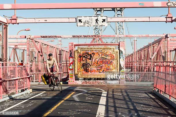 NYC Man Biking Across Williamsburg Bridge from Brooklyn to Manhattan