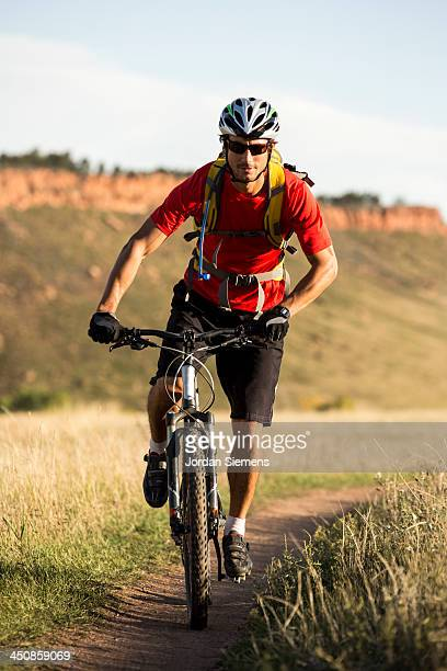 Man biking on a dirt path.