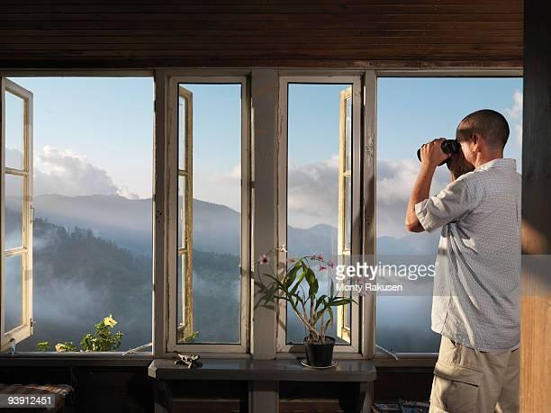 Man & Binoculars Inspecting Plantation
