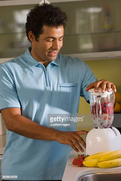 Man blending a smoothie