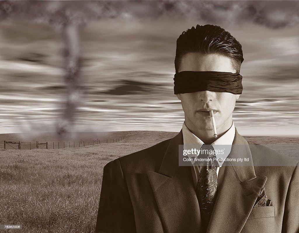 Man blind to impending danger : Stock Photo