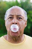 Man blowing a bubble gum bubble