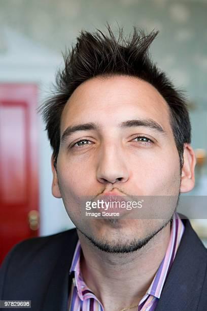 Man blowing a kiss