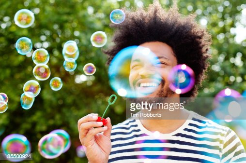 Man blowing bubbles.