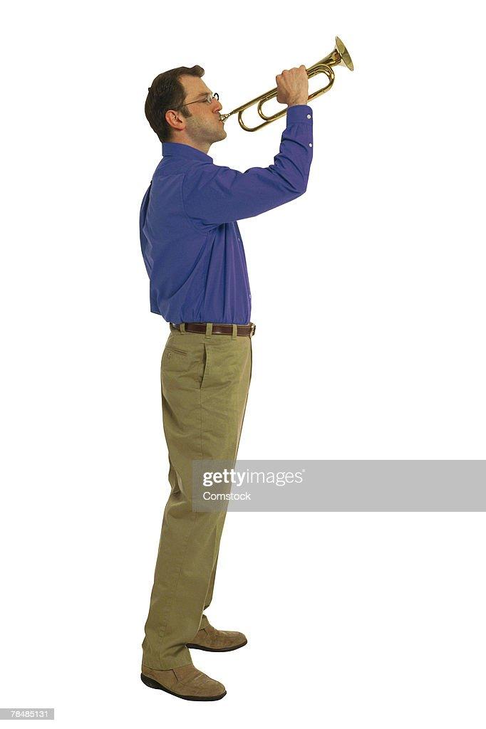 Man blowing bugle