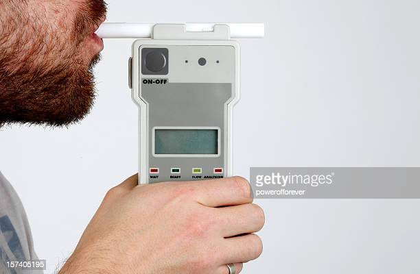 Man Blowing in Breathalyzer