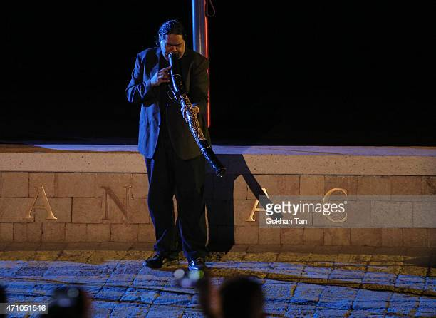 A man blows a didgeridoo during a dawn ceremony marking the 100th anniversary of the Battle of Gallipoli at Anzac Cove on April 25 2015 in...