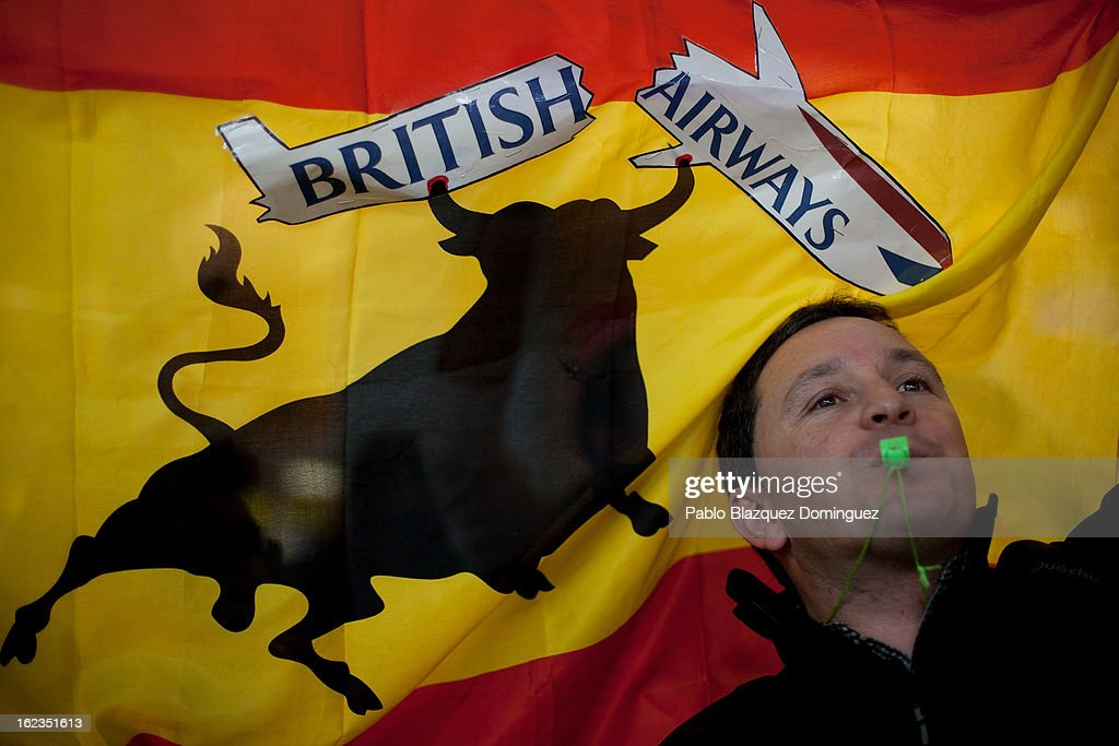 A man blows a whistle and holds a Spanish flag as Spanish Airline Iberia staff stage a protest against job cuts at Barajas Airport on February 22, 2013 in Madrid, Spain. Today is the last of a five day strike held by Iberia cabin crew, maintenance workers and ground staff in response to the planned loss of 3,800 jobs. The strike has resulted in the airline having to cancel 400 flights this week with unions planning more five day strikes in the following weeks.