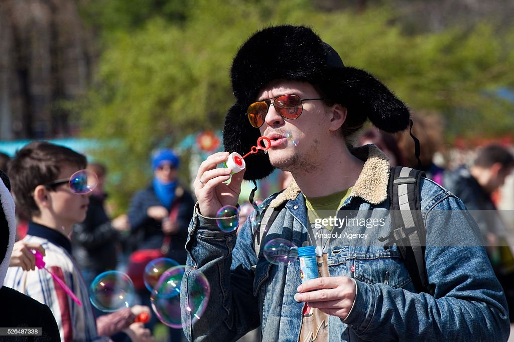 Man blows soap bubbles during the Dreamflash soap bubble festival at the Pervomaisky Square in Novosibirsk, Russia, on April 30, 2016.