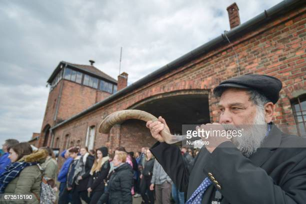 A man blows the shofar during the annual March of the Living Jewish people from Israel and around the world marched the 3km route from Auschwitz to...