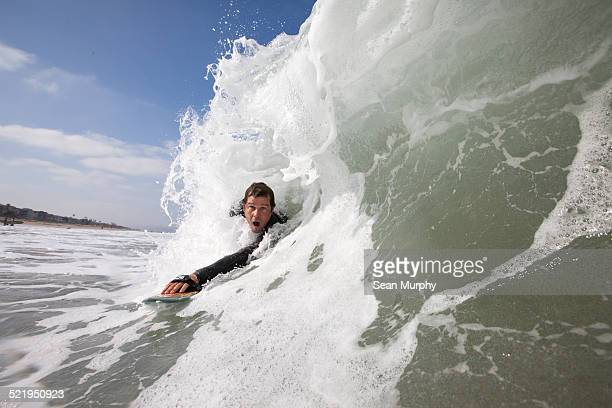 Man Body Surfing on a Hand plane
