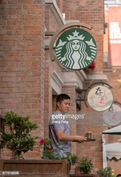 A man bought a coffee walking out of a Starbucks shop Since June 1st 2017 the fulltime employees of Starbucks in Chinese market who have worked for...