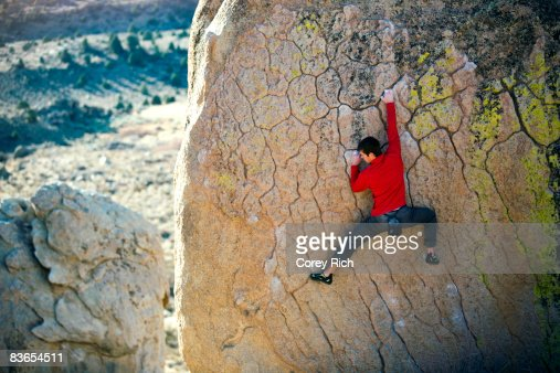Man bouldering on an overhang
