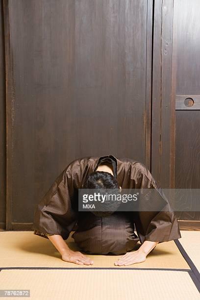 Man bowing