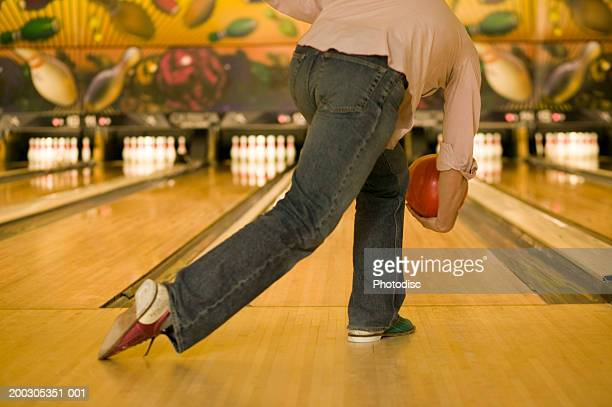 Man bowling ball at pins, low section