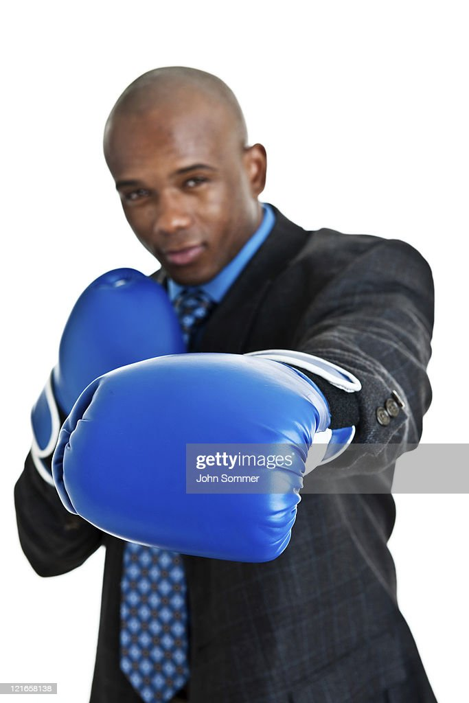 Man boxing wearing a suit