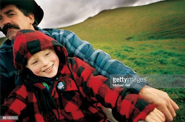 Man & boy on quad-bike