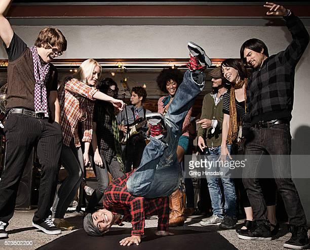 Man break-dancing at party