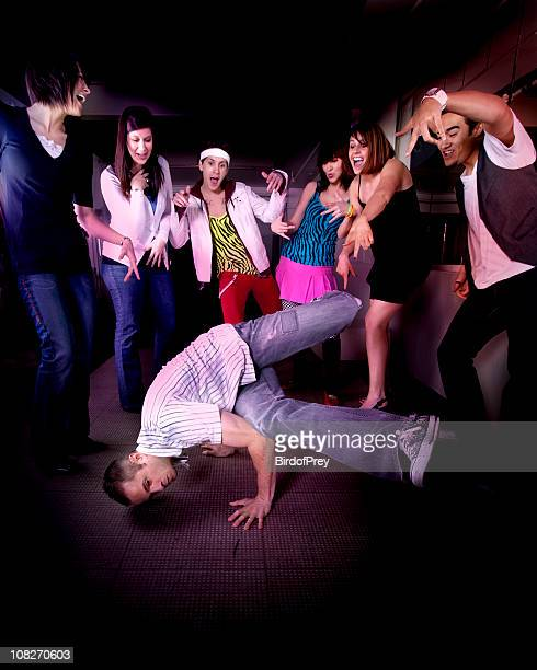 Man Breakdancing with Crowd of People Cheering Him On