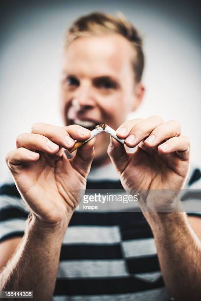 Man breaking a cigarette