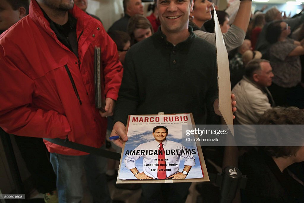 A man brings a poster to be autographed by Republican presidential candidate Sen. Marco Rubio (R-FL) to a campaign town hall meeting at the Southside Christian School February 11, 2016 in Simpsonville, South Carolina. Earlier in the week Rubio placed fifth in the New Hampshire primary, behind fellow GOP candidates Jeb Bush, John Kasich, Sen. Ted Cruz (R-TX) and Donald Trump, who won with 35 percent of the vote.