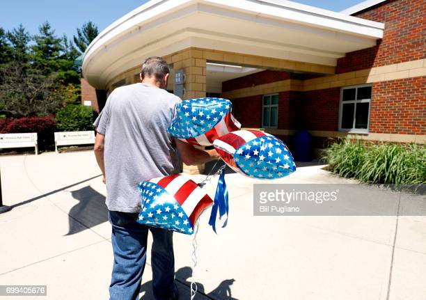 A man brings balloons into Wyoming High School site of tomorrow's funeral for Otto Warmbier June 21 2017 in Wyoming Ohio The 22yearold college...