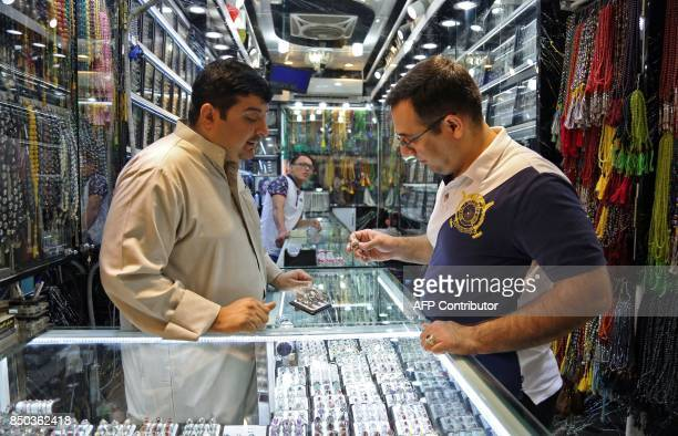 A man browses for rings at a jeweller's in the main market of Iraq's holy city of Najaf on September 13 2017 Strategically located facing the golden...