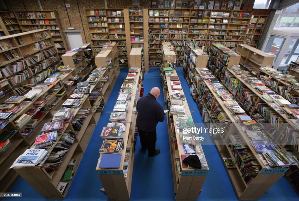 A man browses second hand books at the Bookbarn International on December 12, 2008 near Hallatrow in Somerset, England. Currently selling up to several thousand books a day and mostly online via Web sites such as Amazon.com, Bookbarn International is the UK's largest second hand book warehouse with over 5 million titles stored in two giant barns in a field in Somerset. Helped in part by the credit crunch, sales of second hand books have risen sharply recently with the weak British pound only helping the Bookbarn to sell more books internationally. (Photo by Matt Cardy/Getty Images).
