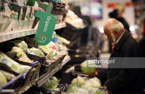 A man browses the organic vegetable section at a Sainsbury's store in east London UK on Monday November 13 2006 Britain's organic food industry has...