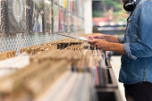 Male browsing vinyl album in a record store