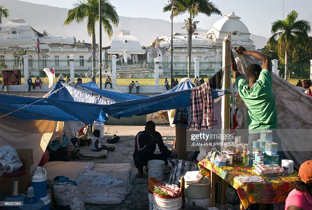 A man brushes his teeth at a makeshift camp in Port-au-Prince on January 23, 2010. More than 110,000 people have been confirmed as killed in Haiti's devastating earthquake, the Interior Ministry said, making it the deadliest on record in the Americas. AFP PHOTO / JEAN-PHILIPPE KSIAZEK