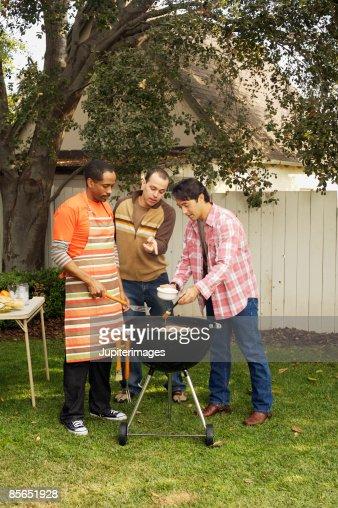 Man brushing marinade on grilling meat