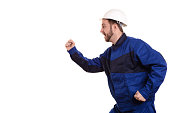 man builder in hard hat and overalls runs for construction isolated on the white background.