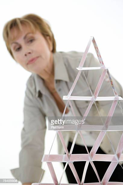 Man building a house of cards.