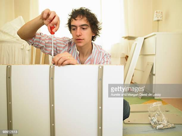Man building furniture