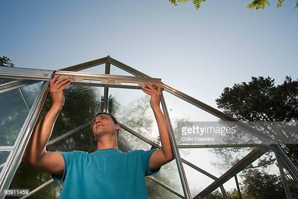 Man building greenhouse