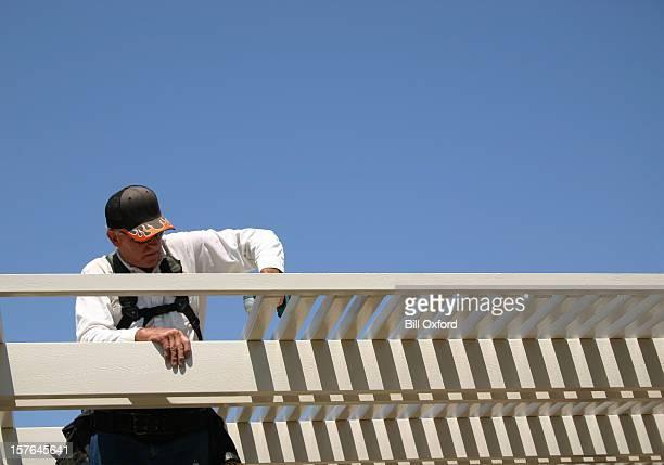 Man building patio awning
