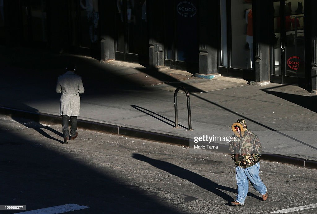 A man bundled up against the cold walks in Manhattan on January 24, 2013 in New York City. Polar air settled in over the northwest U.S. Wednesday, with temperatures in the teens and twenties.