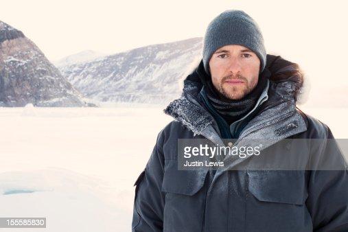 Man bundled with ice on jacket and sun shining : Stock Photo