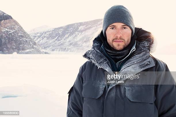 Man bundled with ice on jacket and sun shining