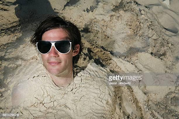 Man Buried in Beach Sand
